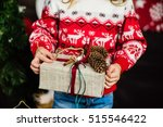 nice girl with christmas present | Shutterstock . vector #515546422