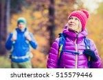 happy couple hikers trekking in ... | Shutterstock . vector #515579446