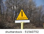 A methane pipeline warning sign in Italian 'metanodotto' - stock photo