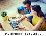 happy couple doing online... | Shutterstock . vector #515615572