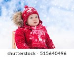 little girl enjoying a sleigh... | Shutterstock . vector #515640496