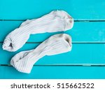 old socks on wood | Shutterstock . vector #515662522