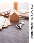 Small photo of house design concept with house paper mockup model and material sample with stone, sample wood ,sample color,pencil with free copy space for yout ideas text