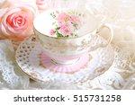 lovely teacup on white table... | Shutterstock . vector #515731258