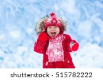 baby playing with snow in... | Shutterstock . vector #515782222
