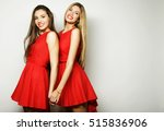 young girls in red dress on