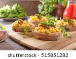 scrambled eggs on toast with... | Shutterstock . vector #515851282