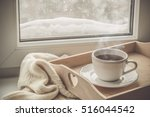 tea on tray and sweater in from ... | Shutterstock . vector #516044542