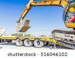 heavy excavator it climbs on... | Shutterstock . vector #516046102