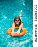 girl in the pool on a buoy | Shutterstock . vector #516065002