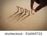 Small photo of TOPIC word of wood alphabet with shadow on cork board,compressed board