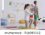 young phsyiotherapist...   Shutterstock . vector #516081112