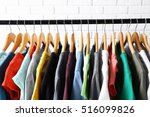 colorful t shirts on hangers... | Shutterstock . vector #516099826