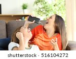 excited friends or sisters... | Shutterstock . vector #516104272