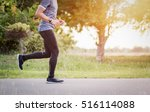 young man is running on road... | Shutterstock . vector #516114088