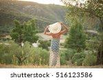 model in olive grove | Shutterstock . vector #516123586