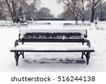 benches in the park in the snow ...