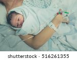 a mother with her newborn child ... | Shutterstock . vector #516261355