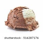 Stock photo vanilla and chocolate ice cream ball isolated on white background 516287176