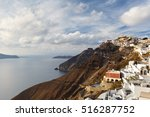 town of fira on santorini... | Shutterstock . vector #516287752