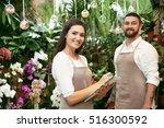 two florists working in... | Shutterstock . vector #516300592