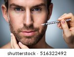 man during surgery filling... | Shutterstock . vector #516322492