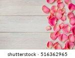 rose petals on the wooden... | Shutterstock . vector #516362965