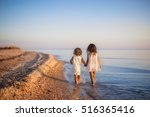 two little girls are on the... | Shutterstock . vector #516365416