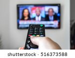 remote in hand | Shutterstock . vector #516373588