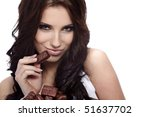 girl eating a chocolate candy | Shutterstock . vector #51637702