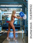 Small photo of Alluring blonde posing in bikini at car wash
