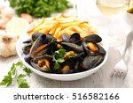 mussel and french fries | Shutterstock . vector #516582166