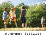girl jumps thourgh hula hoop at ... | Shutterstock . vector #516611398
