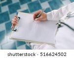 female doctor in white uniform... | Shutterstock . vector #516624502