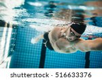 Fit Swimmer Training In The...