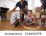 family unpacking boxes in new... | Shutterstock . vector #516642478