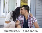 affectionate couple sitting on... | Shutterstock . vector #516646426