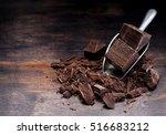 dark chocolate on rustic... | Shutterstock . vector #516683212