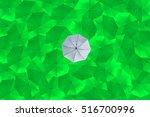 a overturn grey umbrella is... | Shutterstock . vector #516700996