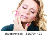 Small photo of Aches and pains concept. Woman having bad ache and pain. Female feel tooth ache touching her mouth from outside by hand palm. Isolated on white.