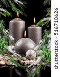 Small photo of Christmas candlestick on Christmas Eve on a christmas background