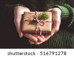 Hands Holding Little Gift With...