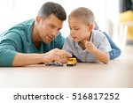 daddy with son playing with car ... | Shutterstock . vector #516817252