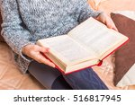 woman reading book on bed top... | Shutterstock . vector #516817945