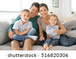 happy family of four sitting on ... | Shutterstock . vector #516820306