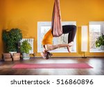 young woman doing antigravity... | Shutterstock . vector #516860896