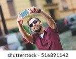 modern man using smartphone... | Shutterstock . vector #516891142