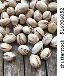 Small photo of Pistachios. Salted pistachios. Pistachios in shell. pistachios close up. Pistachio background.