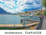 Small photo of Lugano, Switzerland - August 26, 2013: Ship at the landing stage at the promenade of the resort in Lugano on Lake Lugano and Alps mountains in Ticino canton of Switzerland. People on the background
