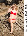 young model with red bikini on... | Shutterstock . vector #516917056
